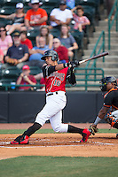 Jose Almonte (16) of the Hickory Crawdads follows through on his swing against the Delmarva Shorebirds at L.P. Frans Stadium on June 18, 2016 in Hickory, North Carolina.  The Crawdads defeated the Shorebirds 1-0 in game one of a double-header.  (Brian Westerholt/Four Seam Images)