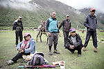 "A group of nomads come to the village after twenty days in high altitude looking for mushrooms . Pema Lham ( the 37 year old woman sitting on the left) is divorced and says : "" We are finally independent . Before we only had the yak "" . Jhomolhari, Bhutan June 2016"