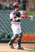 May 10, 2009:  Catcher Jose Morales of the Rochester Red Wings, Triple-A International League affiliate of the Minnesota Twins, waits on the mound for the relief pitcher during a game at Frontier Field in Rochester, NY.  The Red Wings wore special pink jerseys for Mothers Day.  Photo by:  Mike Janes/Four Seam Images