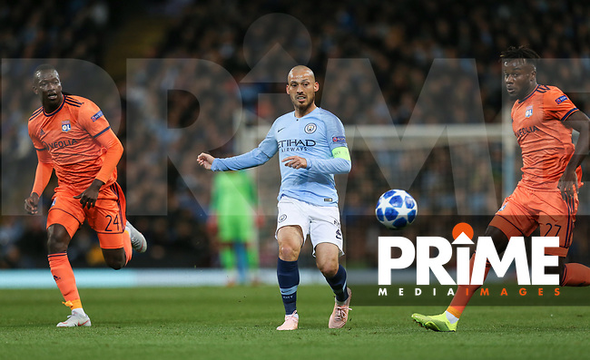 David DAVID SILVA of Manchester City plays the ball past Pape CHEIKH (24) & Maxwel CORNET of Olympique Lyonnais during the UEFA Champions League match between Manchester City and Olympique Lyonnais at the Etihad Stadium, Manchester, England on 19 September 2018. Photo by David Horn / PRiME Media Images.