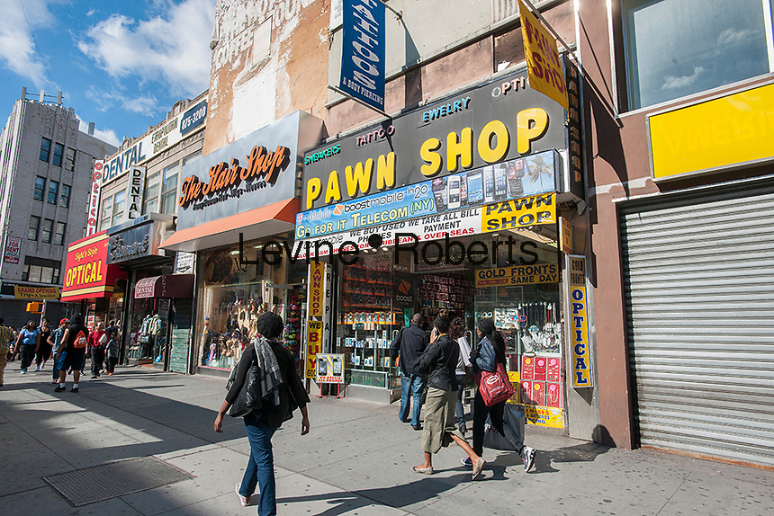 Pawn shop in Downtown Brooklyn in New York on Sunday, September 29, 2013. The area has been for years a middle and lower economic shopping strip but because of increased development in the area, notably hi-rise luxury apartment buildings, chain stores and high-end retailers are moving in. Rents are rising and the smaller mom and pop stores, as well as regional chains are being forced out.  (© Richard B. Levine)