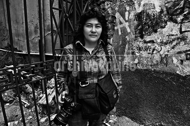 Wara Vargas Lar, the &quot;mom&quot; of the group.They are all between their  20&rsquo;s and 30&rsquo;s. They like to call themselves Kamikazes, and they are the new generation of street photo journalists of Bolivia. In a country where photographers are extremely poorly paid, no one can image that this army of young guys and girls are always ready to risk their lives running behind they care most: a good picture telling a news.<br /> Thought the new eyes of this young generation, our photographer and friend in La Paz, French born Cristian Lombardi shows the impacting reality of this South American mostly indigenous nation. In a patient work, Lombardi edited thousands of frames to show as a glimpse of what these new young eyes are watching.