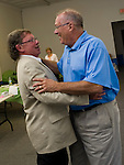 TORRINGTON, CT-10 September 2013-091013EC12--   Mayoral candidate George Craig hugs Democratic Town Committee Chairman Glenn McLeod at the party's headquarters on Water Street in Torrington Tuesday night.  Erin Covey Republican-American