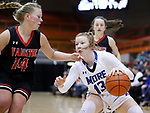 February 28, 2020; Yankton at St. Thomas More High School Basketball -- Haleigh Timmer #13 of St. Thomas More drives into Yankton defender Sadie Fedders #14 during their game Friday evening at Barnett Arena in Rapid City, S.D.(Photo by Richard Carlson/Inertia)