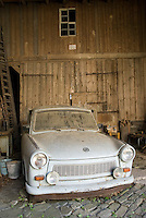 Oberweissbach, National Park Thueringer Wald, Thueringen, Germany, June 2009. A Trabi, Trabant, in a barn. Remnants of the East German Democratic Republic are still visible in Oberweissbach. Many hiking trails such as the famous Rennsteig and the Goldpfad cross the thuringia forest. Photo by Frits Meyst/Adventure4ever.com