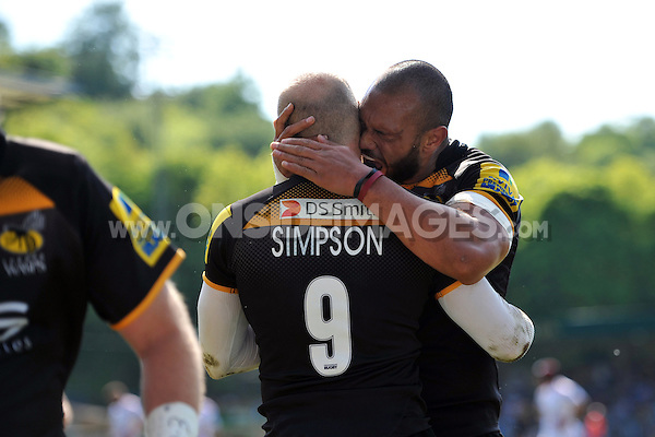 Joe Simpson is congratulated by Will Helu after scoring a try. European Champions Cup play-off, between London Wasps and Stade Francais on May 18, 2014 at Adams Park in High Wycombe, England. Photo by: Patrick Khachfe / JMP