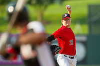 Kannapolis Intimidators relief pitcher Ryan Bollinger (31) delivers a pitch to the plate against the Hickory Crawdads at CMC-Northeast Stadium on July 28, 2013 in Kannapolis, North Carolina.  The Crawdads defeated the Intimidators 6-1.  (Brian Westerholt/Four Seam Images)