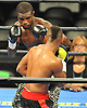 Titus Williams, an Elmont native, left, battles Micah Branch during a Premier Boxing Champions match at the Barclays Center on Saturday, August 1, 2015. Williams, making his professional debut, won the four-round bout by unanimous decision. <br /> <br /> James Escher