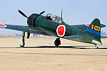 A Mitsubishi built A6M3 Zero fighter sits on the tarmac at Minter Field during the 2007 Warbirds in Action Airshow. One of three still flying in the world today the aircraft was recovered from New Guinea in 1991, restored, and returned to flying condition in 1998. The aircraft is flown regularly by the Southern california Wing of the Commemerative Air Force. Photographed 04/08