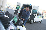 Garda Anita O'Shea packing up the Garda Van at the Lourdes Church where bags of donations were dropped off for Flood Victims...Photo NEWSFILE/Jenny Matthews.(Photo credit should read Jenny Matthews/NEWSFILE)....This Picture has been sent you under the condtions enclosed by:.Newsfile Ltd..The Studio,.Millmount Abbey,.Drogheda,.Co Meath..Ireland..Tel: +353(0)41-9871240.Fax: +353(0)41-9871260.GSM: +353(0)86-2500958.email: pictures@newsfile.ie.www.newsfile.ie.FTP: 193.120.102.198.