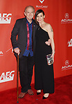 LOS ANGELES, CA - FEBRUARY 10: Musician Benmont Tench (L) and wife Alice Carbone Tench attend MusiCares Person of the Year honoring Tom Petty at the Los Angeles Convention Center on February 10, 2017 in Los Angeles, California.