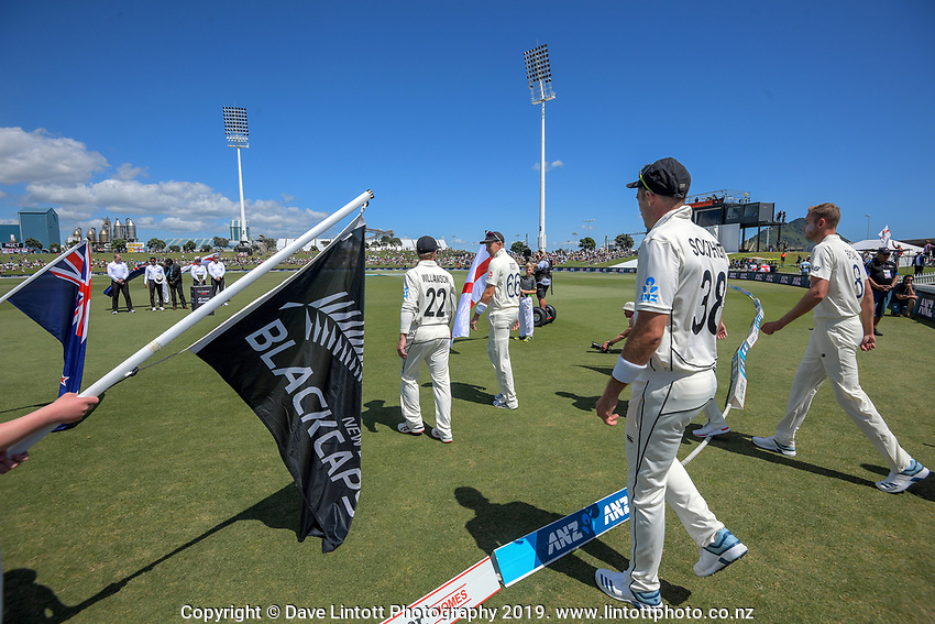 The teams walk out for day one of the international cricket 1st test match between NZ Black Caps and England at Bay Oval in Mount Maunganui, New Zealand on Thursday, 21 November 2019. Photo: Dave Lintott / lintottphoto.co.nz