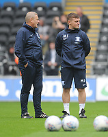 Preston North End First Team Coach Frankie McAvoy (left) and First Team Physio Matt Jackson during the pre-match warm-up <br /> <br /> Photographer Kevin Barnes/CameraSport<br /> <br /> The EFL Sky Bet Championship - Swansea City v Preston North End - Saturday August 11th 2018 - Liberty Stadium - Swansea<br /> <br /> World Copyright &copy; 2018 CameraSport. All rights reserved. 43 Linden Ave. Countesthorpe. Leicester. England. LE8 5PG - Tel: +44 (0) 116 277 4147 - admin@camerasport.com - www.camerasport.com