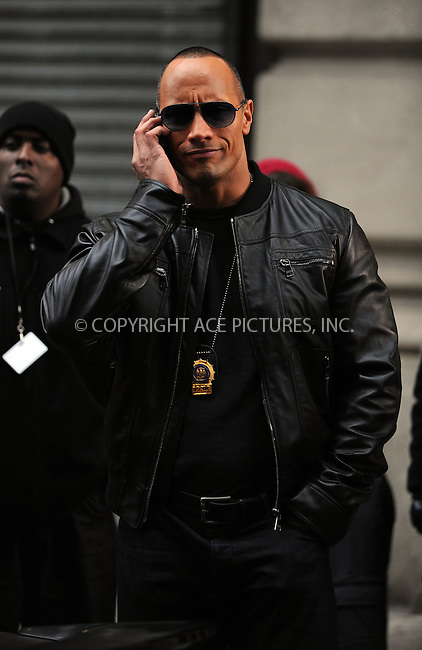 WWW.ACEPIXS.COM . . . . .  ....October 23 2009, New York City....Actor Dwayne Johnson on the midtown Manhattan set of 'The Other Guys' on October 23 2009 in New York City....Please byline: AJ Sokalner - ACEPIXS.COM.... *** ***..Ace Pictures, Inc:  ..(212) 243-8787 or (646) 769 0430..e-mail: picturedesk@acepixs.com..web: http://www.acepixs.com