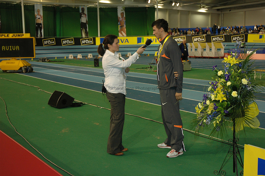 Photo: Tony Oudot/Richard Lane Photography. Aviva World Trials & UK Championships. 14/02/2010. .Mens Pole Vault. .Winner Steve Lewis is interviewed by Zarah Al-Kudcy.