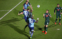 Dayle Southwell of Wycombe Wanderers beats Oscar Threlkeld of Plymouth Argyle to head a shot at goal during the Sky Bet League 2 match between Wycombe Wanderers and Plymouth Argyle at Adams Park, High Wycombe, England on 14 March 2017. Photo by Andy Rowland / PRiME Media Images.