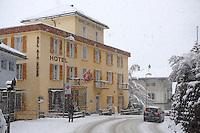 Grindelwald town with Hotel Bel Air Eden  in the winter snow. Ski resort - Swiss Alps