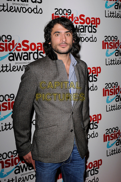 MARC ELLIOTT.The Inside Soap Awards 2009, Sketch, London, England. .September 28th, 2009 .half length grey gray suit jacket beard stubble facial hair.CAP/FIN.©Steve Finn/Capital Pictures.