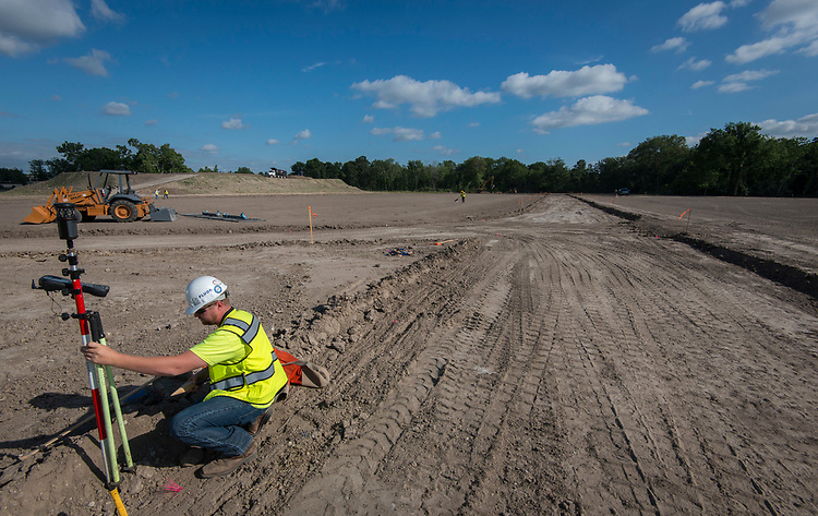 Surveying athletic field during construction at North Forest High School, May 16, 2017.