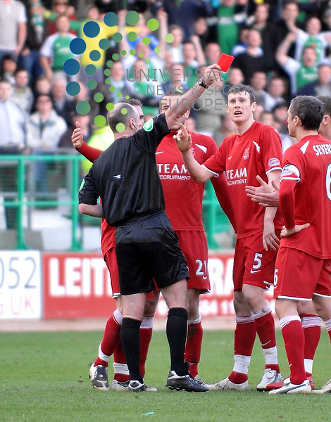 Mike McCurry tries to intervene when Mark Kerr and Rob Jones squared up to each other which resulted in kerr being sent off for a head-butt during the Hibs v Aberdeen SPL match at Easter Road Stadium.