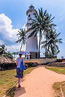 Photo of a tourist visiting Galle lighthouse in the Old Town of Galle, UNESCO World Heritage Site, Sri Lanka, Asia. This is a photo of a tourist visiting Galle lighthouse in the Old Town of Galle, a UNESCO World Heritage Site in Sri Lanka, Asia.