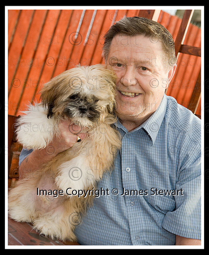 02/12/2008  Copyright Pic: James Stewart.File Name : sct_jspa02_bil_munnoch.BILL MUNNOCH FROM FALKIRK WITH SHIH-TZU, HAMISH. MR MUNNOCH HAS OFFERED HAMISH TO AMERICAN PRESIDNT ELECT BARAK OBAMA AS A PET FOR HIS CHILDREN......James Stewart Photo Agency 19 Carronlea Drive, Falkirk. FK2 8DN      Vat Reg No. 607 6932 25.Studio      : +44 (0)1324 611191 .Mobile      : +44 (0)7721 416997.E-mail  :  jim@jspa.co.uk.If you require further information then contact Jim Stewart on any of the numbers above.........