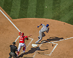 1 June 2014: Texas Rangers infielder Elvis Andrus lays down a bunt during a game against the Washington Nationals at Nationals Park in Washington, DC. The Rangers shut out the Nationals 2-0 to salvage the third the third game of their 3-game inter-league series. Mandatory Credit: Ed Wolfstein Photo *** RAW (NEF) Image File Available ***