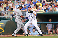 Royals first baseman Mike Sweeney holds Detroit Tigers shortstop Carlos Guillen on first at Kauffman Stadium in Kansas City, Missouri on May 5, 2007.