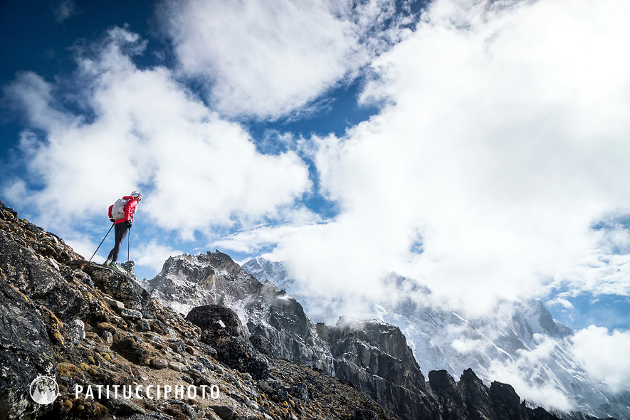 A trail runner heading up the first of 3 Passes, Kongma La, while running the 3 Passes tour in the Khumbu Valley, Nepal.