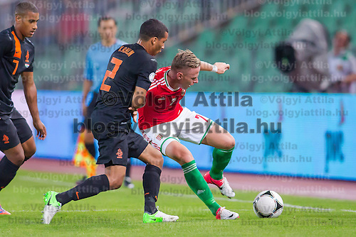 Netherlands' Ricardo van Rhijn (L) and Hungary's Balazs Dzsudzsak (R) fight for the ball during a World Cup 2014 qualifying soccer match Hungary playing against Netherlands in Budapest, Hungary on September 11, 2012. ATTILA VOLGYI