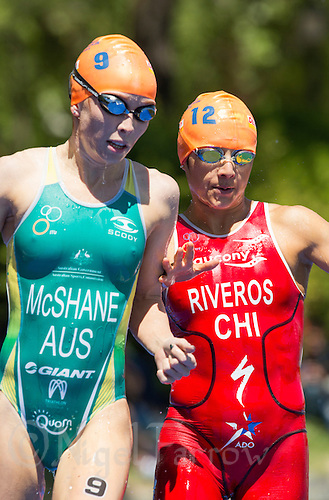 01 JUN 2013 - MADRID, ESP - Charlotte McShane (AUS) (left) of Australia and Barbara Riveros Diaz (CHI) (right) of Chile prepare to dive into the water for the start of the second swim lap at the elite women's ITU 2013 World Triathlon Series round in Casa de Campo, Madrid, Spain (PHOTO (C) 2013 NIGEL FARROW)