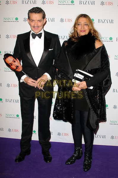 GUEST & ZAHA HADID.The Surrealist Ball in aid of NSPCC at The Banqueting House, London, England..March 17th, 2011.full length black tuxedo mask wrap coat jacket tights .CAP/CJ.©Chris Joseph/Capital Pictures