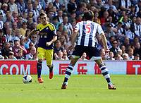 Pictured L-R: Pablo Hernandez of Swansea against Claudio Yacob of West Brom. Sunday 01 September 2013<br />