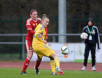 20150404 - FORST , GERMANY  : Ukrainian Veronika Andrukhiv pictured in a duel with Belgian Chloe Van Mingeroet (left) during the soccer match between Women Under 19 teams of Belgium and Ukraine , on the first matchday in group 5 of the UEFA Elite Round Women Under 19 at WaldseeStadion , Forst , Germany . Saturday 4th April 2015 . PHOTO DAVID CATRY