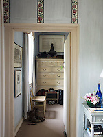 The dressing room leading off the master bedroom is hung with a collection of antique prints