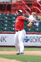 Erie Seawolves third baseman Francisco Martinez (20) throws to first during a game against the Binghamton Mets on July 13, 2014 at Jerry Uht Park in Erie, Pennsylvania.  Binghamton defeated Erie 5-4.  (Mike Janes/Four Seam Images)