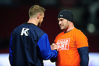 Marc Jones of Bristol Rugby speaks with Rhys Priestland of Bath Rugby during the pre-match warm-up. European Rugby Challenge Cup match, between Bristol Rugby and Bath Rugby on January 13, 2017 at Ashton Gate Stadium in Bristol, England. Photo by: Patrick Khachfe / Onside Images