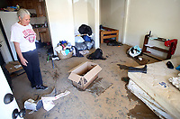 NWA Democrat-Gazette/DAVID GOTTSCHALK   Tammy Linder surveys the damage and debris Tuesday, May 2, 2017, inside her residence at the West End Apartments in Fayetteville. Rain and a swollen creek caused flooding at the Apartment causing extensive water damage inside the apartments and to personal property.