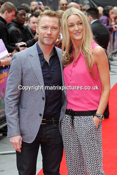 NON EXCLUSIVE PICTURE: PAUL TREADWAY / MATRIXPICTURES.CO.UK<br /> PLEASE CREDIT ALL USES<br /> <br /> WORLD RIGHTS<br /> <br /> Irish singer Ronan Keating and his girlfriend Storm Uechtritz attend the World Premiere of Postman Pat: The Movie, Odeon West End, London.<br /> <br /> MAY 11th 2014<br /> <br /> REF: PTY 142244