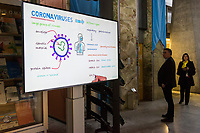 A public information film on what is presently known about the coronavirus, displaying on a video screen in the World Health Organization (WHO) headquarters.