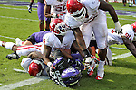 Oklahoma Sooners defensive back Demontre Hurst (6) and TCU Horned Frogs running back B.J. Catalon (23) in action during the game between the Oklahoma Sooners and the TCU Horned Frogs  at the Amon G. Carter Stadium in Fort Worth, Texas. OU defeats TCU 24 to 17.