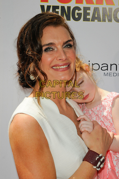 "BROOKE SHIELDS with her daughter Rowan .The Los Angeles premiere of ""Furry Vengeance"" at Mann Bruin Theatre in Westwood, California, USA..April 18th, 2010 .headshot portrait hair up earrings silver white scallop edge edged wavy trim smiling kid child mother mom mum family pink holding hands bracelet .CAP/ROT.©Lee Roth/Capital Pictures"