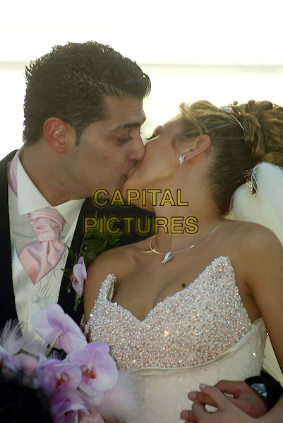 ALEX POYIADZIS & ELIZABETH ARICALI.Peter Andre's cousin's wedding, Alex Poyiadzis to Elizabeth Aricali, at St John's Greek Church in North London, England, 26th  August 2007..half length bride and groom family kissing marriage.CAP/IL.©Ian Leonard/Capital Pictures.