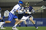 DURHAM, NC - APRIL 28: Notre Dame's Ryder Garnsey (right) takes a shot past Duke's Cade Van Raaphorst (left). The Duke University Blue Devils played the University of Notre Dame Fighting Irish on April 28, 2017, at Koskinen Stadium in Durham, NC in a 2017 ACC Men's Lacrosse Tournament Semifinal match. Notre Dame won the game 7-6.