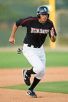 Jose Vargas #13 of the Kannapolis Intimidators advances to third base after tagging on a fly ball at Fieldcrest Cannon Stadium April 25, 2010, in Kannapolis, North Carolina.  Photo by Brian Westerholt / Four Seam Images