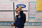 Education Preschool classroom scenes 4-5 year olds girl spinning tamborine on her finger