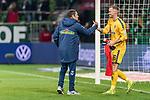 02.11.2019, wohninvest WESERSTADION, Bremen, GER, 1.FBL, Werder Bremen vs SC Freiburg<br /> <br /> DFL REGULATIONS PROHIBIT ANY USE OF PHOTOGRAPHS AS IMAGE SEQUENCES AND/OR QUASI-VIDEO.<br /> <br /> im Bild / picture shows<br /> Andreas Kronenberg (Torwart-Trainer SC Freiburg) klatscht mit Mark Flekken (SC Freiburg #26) nach Spielende ab, <br /> <br /> Foto © nordphoto / Ewert