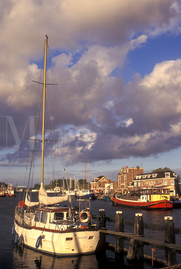 Netherlands, Holland, Groningen, Delfzijl, North Sea, Europe, Boats docked along the harbor of Delfzijl on the North Sea.