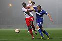 Lucas Akins of Stevenage tussles with Gabor Gyepes of Portsmouth.  Stevenage v Portsmouth - npower League 1 -  Lamex Stadium, Stevenage - 23rd October, 2012. © Kevin Coleman 2012.