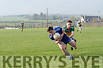 Annascaul Killian Falvey in possession of the ball tackled by Knocknagoshel Denis Collins during the Junior Club Championship Group 1 Round 3 match at Paddy Kennedy Memorial Park, Annascaul, on Saturday evening.